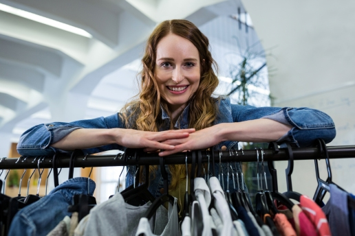 Woman leaning on a clothes rack